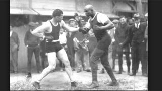 Jack Dempsey spars with George Godfrey