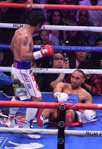 Manny Pacquiao stands over Keith Thurman